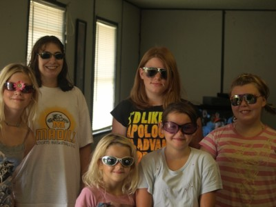 A few of the youth show off decorated sunglasses